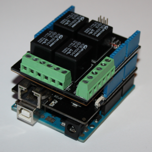 An Arduino Uno, an Ethernet Shield, and a Relay Shield